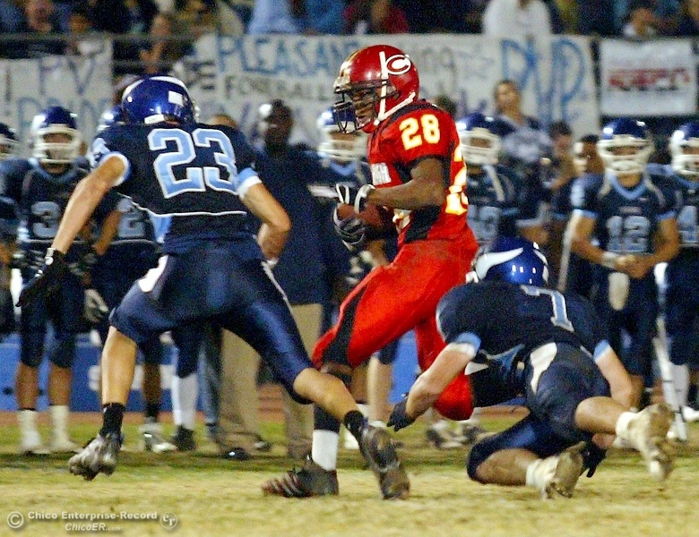 . Chico High\'s #28 Jamiel Hardman (center) rushes against Pleasant Valley High\'s #23 Mycal Swaim (left) and #7 Brandon Nickas (right) in the first quarter of their 2008 Almond Bowl Football game Friday, October 17, 2008 at CSUC University Stadium in Chico, CA. 