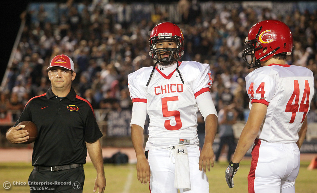 . Chico High\'s head coach Jason Alvistur (left) #5 Trevon Reid (center), and #44 Mark Jorgensen (right) readies against Pleasant Valley High before the first quarter during their Almond Bowl XLI football game at CSUC University Stadium Friday, October 21, 2011 in Chico, Calif. (Jason Halley/Chico Enterprise-Record)
