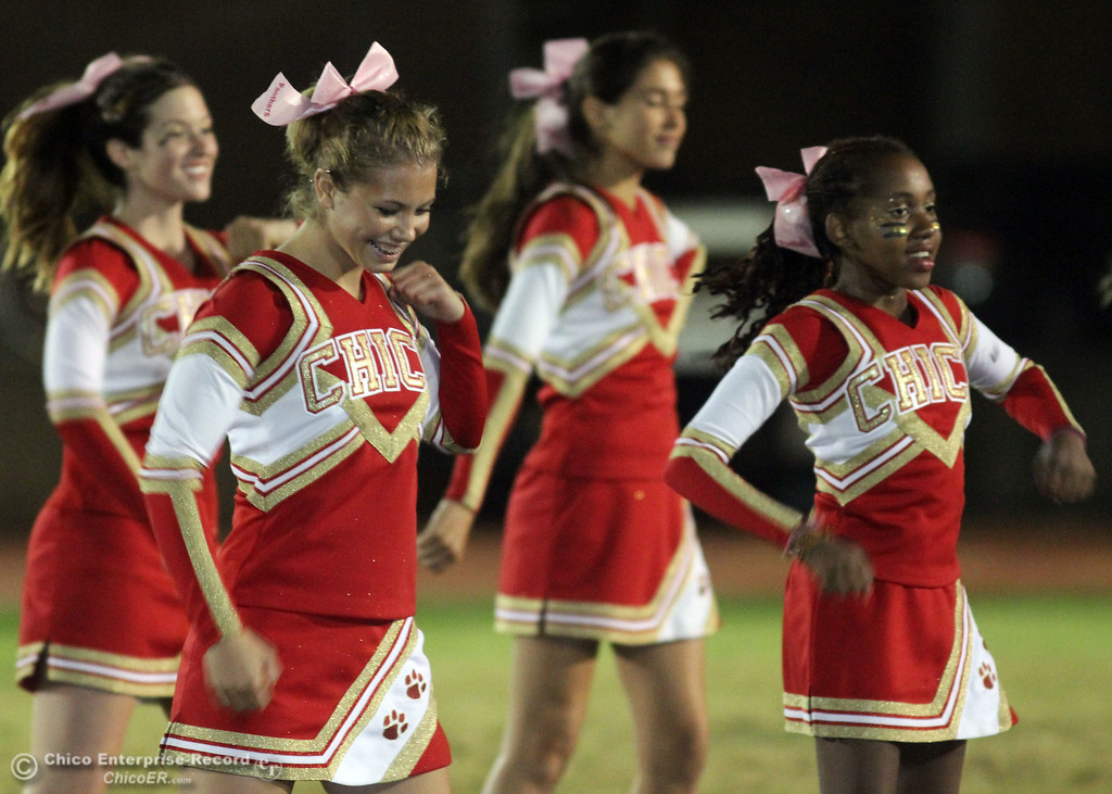 . Pleasant Valley High against Chico High cheerleaders do a routine in the first quarter of their Almond Bowl football game at CSUC University Stadium Friday, October 22, 2010 in Chico, Calif.