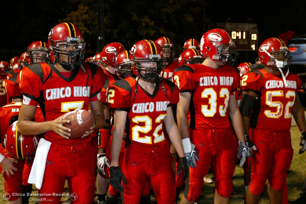 . Chico High\'s #7 Nate Anderson, #22 Austin Somhegyi, #33 Kayhan Karatekeli, and #52 Anthony Jones (left to right) against Pleasant Valley High in the first quarter of their 2008 Almond Bowl Football game Friday, October 17, 2008 at CSUC University Stadium in Chico, CA. 