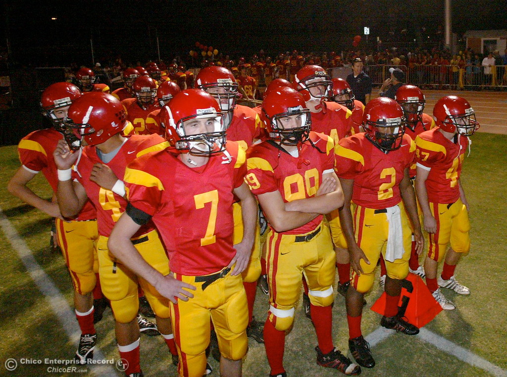 . Chico High\'s #7 Kyle Quackenbush, #9 9Jessen Cole, #2 Jamiel Hardman, and #47 Ian Boyer (left to right) come onto the field against Pleasant Valley High in the first quarter of their Almond Bowl football game at CSUC University Stadium Friday, October 16, 2009 in Chico, Calif. (Jason Halley/Chico Enterprise-Record)