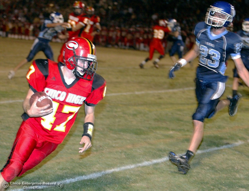 . Chico High\'s #47 Ian Boyer (left) rushes in for a two-point conversion against Pleasant Valley High in the second quarter of their 2008 Almond Bowl Football game Friday, October 17, 2008 at CSUC University Stadium in Chico, CA. 