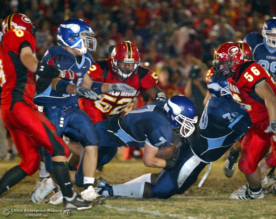 . Chico High tackles Pleasant Valley High\'s #7 Brandon Nickas (center) in the first quarter of their 2008 Almond Bowl Football game Friday, October 17, 2008 at CSUC University Stadium in Chico, CA. 