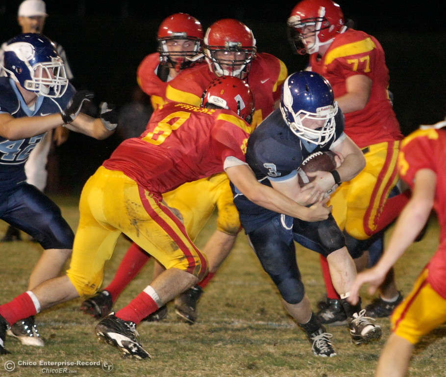 . Chico High\'s #8 Bryson Fricke (left) tackles against Pleasant Valley High\'s #3 Ryan Powers in the first quarter of their Almond Bowl football game at CSUC University Stadium Friday, October 16, 2009 in Chico, Calif. (Jason Halley/Chico Enterprise-Record)