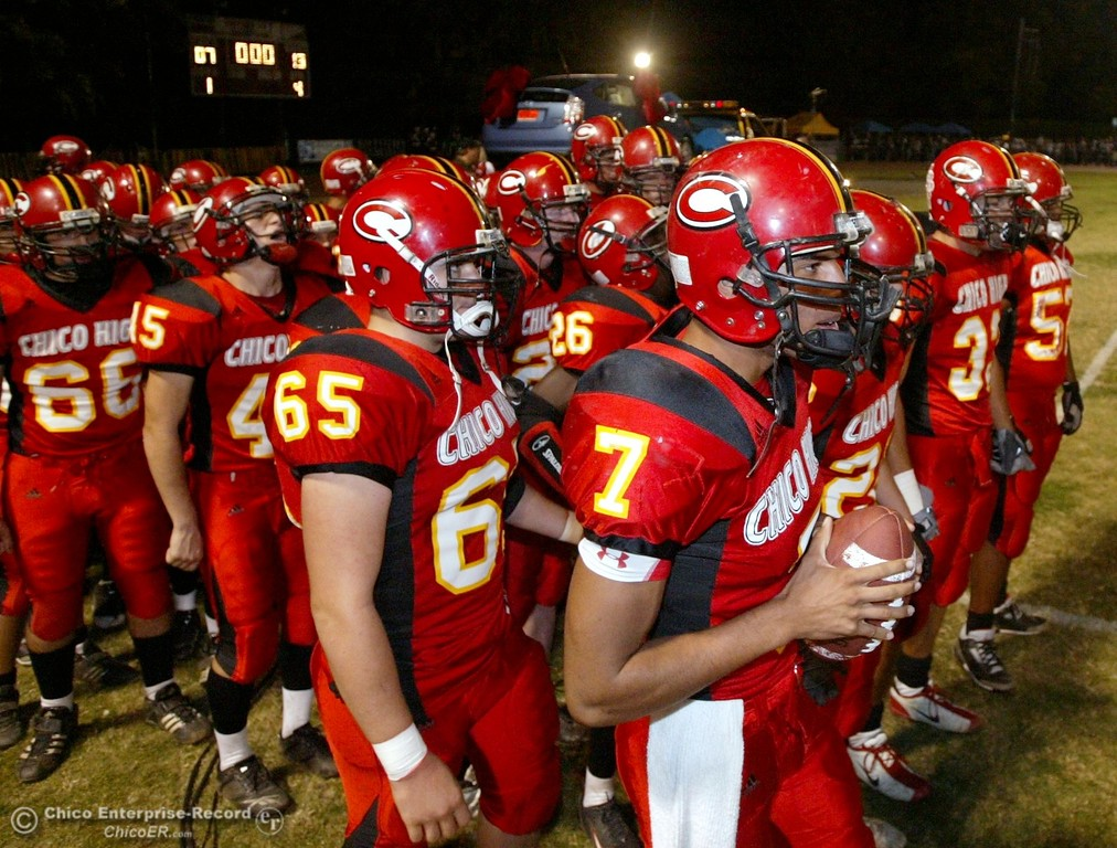 . Chico High\'s #7 Nate Anderson, (right) leads against Pleasant Valley High in the first quarter of their 2008 Almond Bowl Football game Friday, October 17, 2008 at CSUC University Stadium in Chico, CA. 