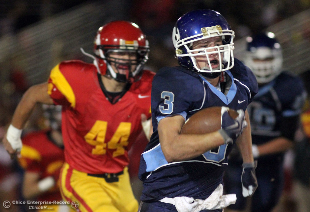 . Pleasant Valley High\'s #3 Gary Hemmingsen (right) rushes against Chico High\'s #44 Mark Jorgensen (left) in the second quarter of their Almond Bowl football game at CSUC University Stadium Friday, October 22, 2010 in Chico, Calif.