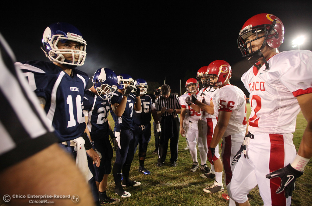 . Pleasant Valley High\'s #10 Eric Ascencio, #22 Michael Gerlach, #7 Kyle Forbis, and #65 Carlos Jauregui have the coin toss against Chico High\'s #53 Adam Rose, #44 Mark Jorgensen, #56 Ted Staiger, and #2 Aaron Chu (left to right) in the first quarter during their Almond Bowl XLI football game at CSUC University Stadium Friday, October 21, 2011 in Chico, Calif. (Jason Halley/Chico Enterprise-Record)