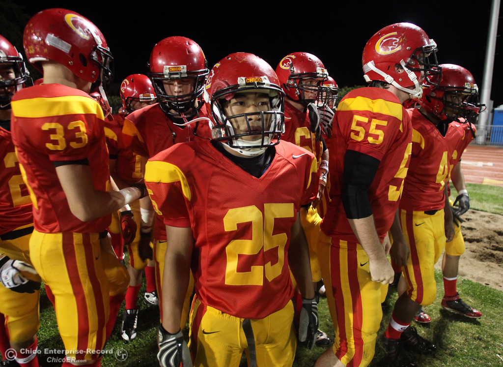 . Pleasant Valley High against Chico High\'s #33 Zack Heckerson, #25 Ger Lee, #55 Weston Haight (left to right) in the first quarter of their Almond Bowl football game at CSUC University Stadium Friday, October 22, 2010 in Chico, Calif.