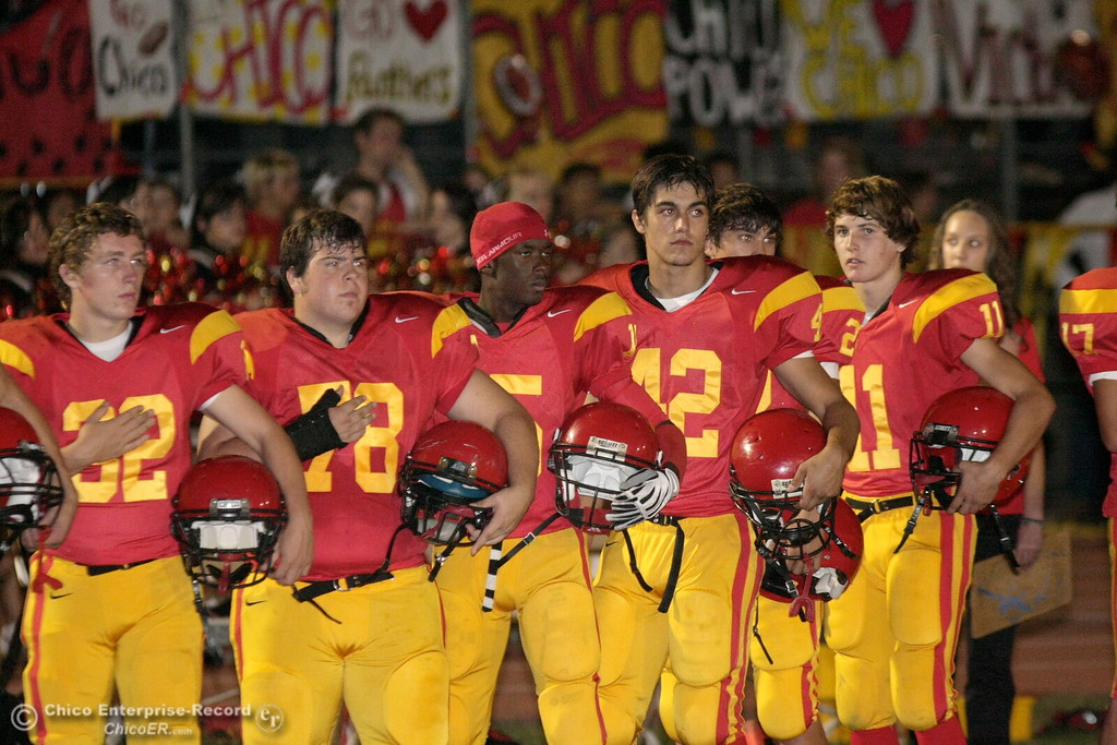 . Chico High against Pleasant Valley High during the national anthem before the first quarter of their Almond Bowl football game at CSUC University Stadium Friday, October 16, 2009 in Chico, Calif. (Jason Halley/Chico Enterprise-Record)