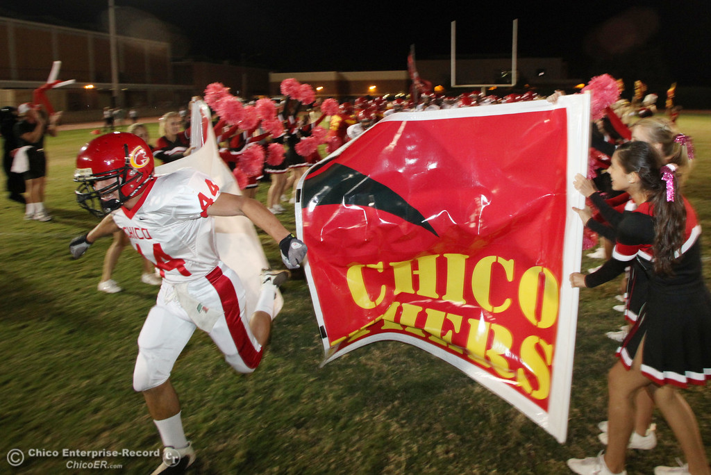 . Chico Highs #44 Mark Jorgensen and team take the field against Pleasant Valley High before the first quarter during their Almond Bowl XLI football game at CSUC University Stadium Friday, October 21, 2011 in Chico, Calif. (Jason Halley/Chico Enterprise-Record)