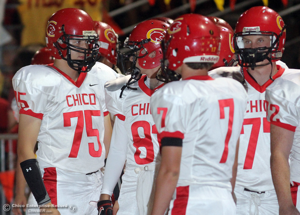 . Chico High\'s #75 Will Bame (left) and others against Pleasant Valley before the first quarter during their Almond Bowl XLI football game at CSUC University Stadium Friday, October 21, 2011 in Chico, Calif. (Jason Halley/Chico Enterprise-Record)