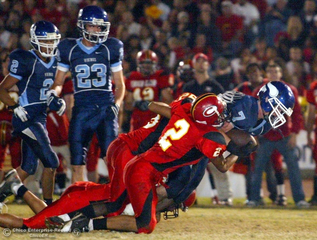. Chico High\'s #2 Terence Ellis (left) tackles against Pleasant Valley High\'s #7 Brandon Nickas in the first quarter of their 2008 Almond Bowl Football game Friday, October 17, 2008 at CSUC University Stadium in Chico, CA. 