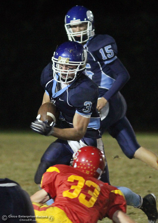 . Pleasant Valley High\'s #3 Gary Hemmingsen (center) rushes against Chico High\'s #33 Zack Hendersen (bottom) in the second quarter of their Almond Bowl football game at CSUC University Stadium Friday, October 22, 2010 in Chico, Calif.