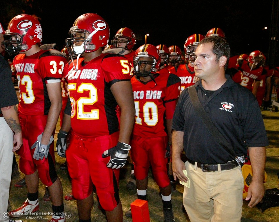 . Chico High\'s coach Jason Alvistur (right) against Pleasant Valley High in the first quarter of their 2008 Almond Bowl Football game Friday, October 17, 2008 at CSUC University Stadium in Chico, CA. 