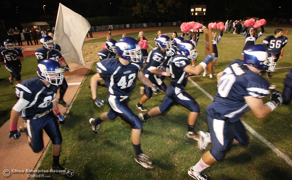 . Pleasant Valley High takes the field against Chico High before the first quarter during their Almond Bowl XLI football game at CSUC University Stadium Friday, October 21, 2011 in Chico, Calif. (Jason Halley/Chico Enterprise-Record)