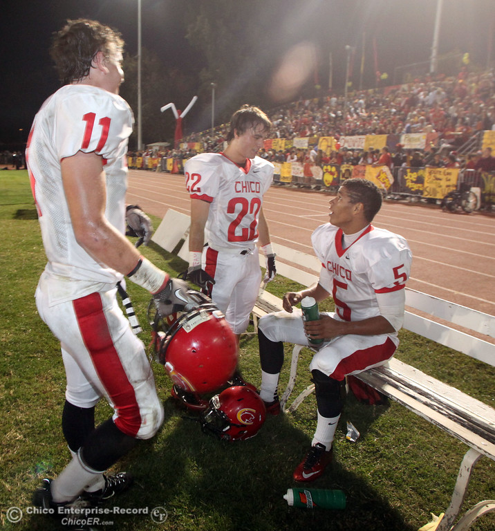 . Chico High\'s #11 Jesse Holmes, #22 Stefano Disano, and #5 Trevon Reid (left to right) against Pleasant Valley High in the second quarter during their Almond Bowl XLI football game at CSUC University Stadium Friday, October 21, 2011 in Chico, Calif. (Jason Halley/Chico Enterprise-Record)