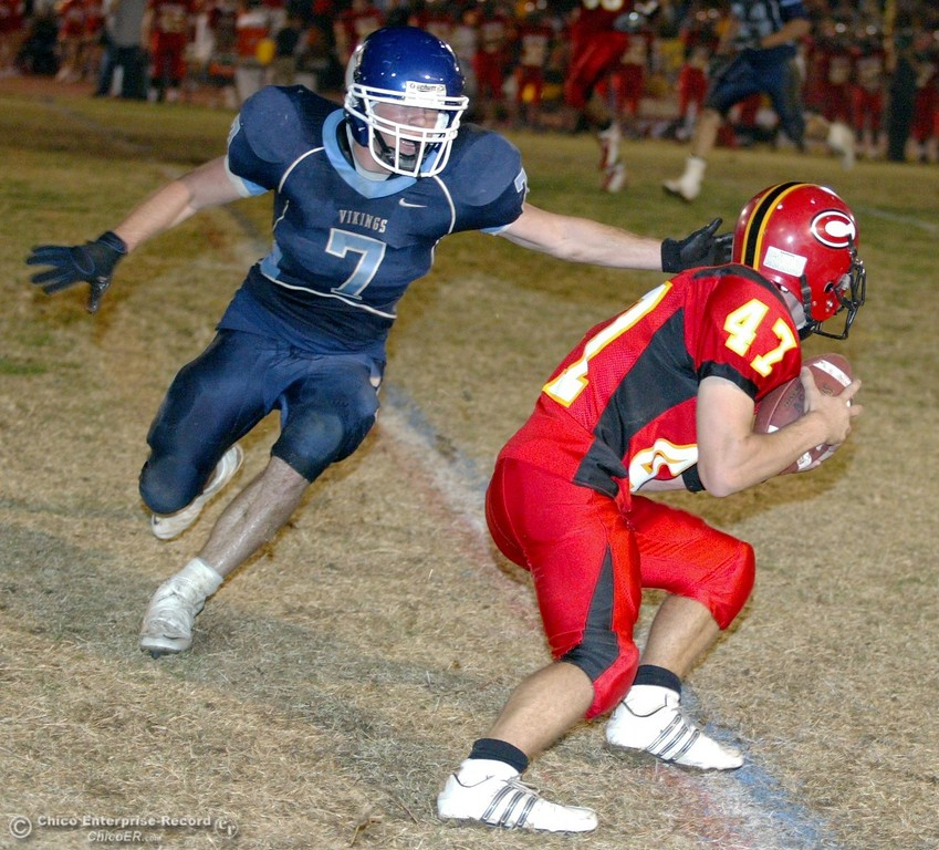 . Chico High\'s #47 Ian Boyer (right) completes a catch against Pleasant Valley High\'s #7 Brandon Nickas (left) in the first quarter of their 2008 Almond Bowl Football game Friday, October 17, 2008 at CSUC University Stadium in Chico, CA. 