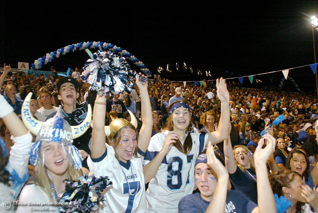 . Pleasant Valley High\'s fans Brittany Burger, 17, Kristen Francis, 17, Allie Grant, 17 and Jacob Hamada, 16 (left to right in front row) cheer against Chico High at half time of their Almond Bowl football game at CSUC University Stadium Friday, October 16, 2009 in Chico, Calif. (Jason Halley/Chico Enterprise-Record)