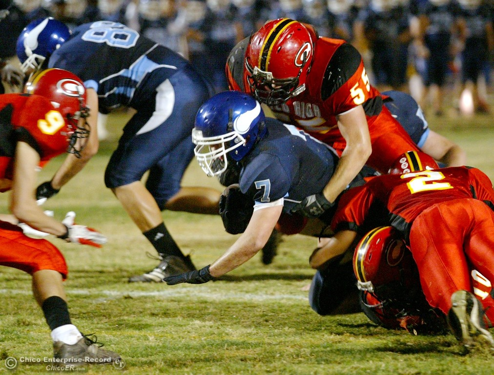 . Chico High tackles against Pleasant Valley High\'s #7 Brandon Nickas (center) in the first quarter of their 2008 Almond Bowl Football game Friday, October 17, 2008 at CSUC University Stadium in Chico, CA. 