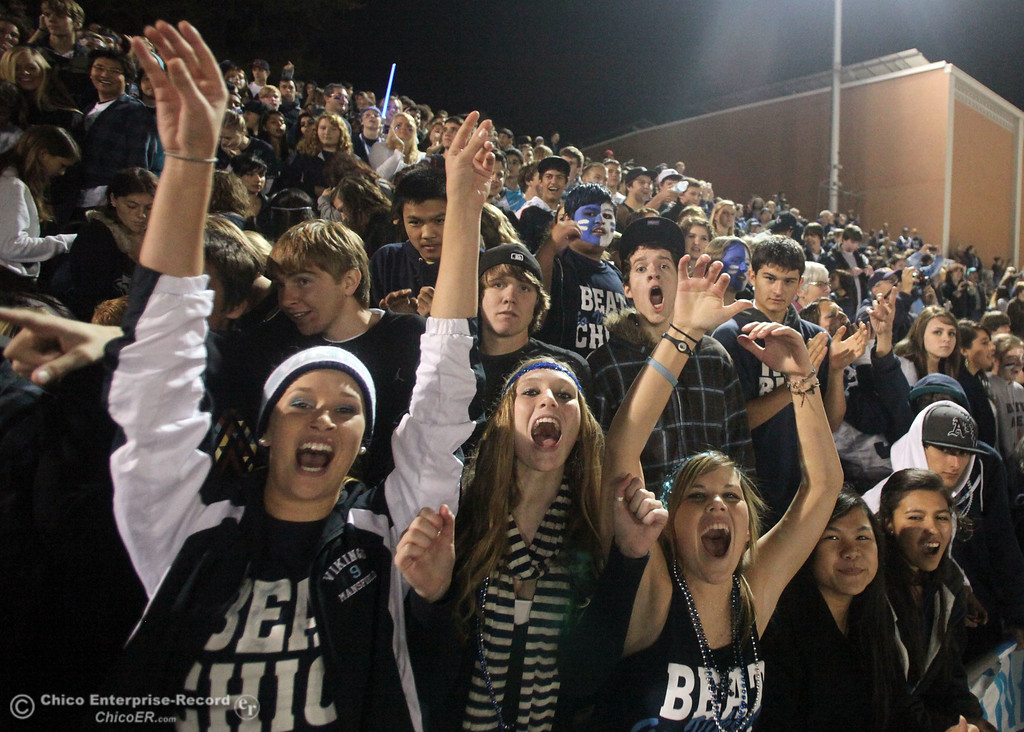 . Kiley Mansfield, Caitlin Dunn, and Mary Silva (left to right, front row) cheer on Pleasant Valley High against Chico High in the second quarter of their Almond Bowl football game at CSUC University Stadium Friday, October 22, 2010 in Chico, Calif.