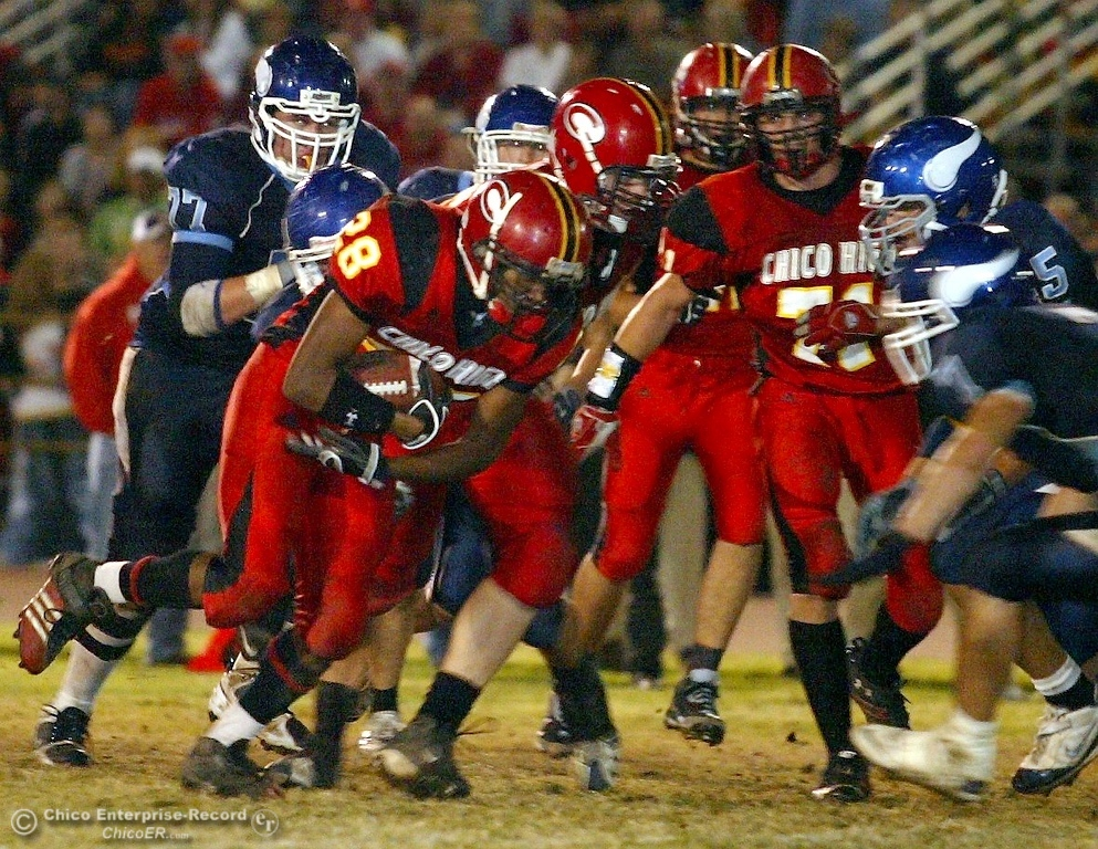 . Chico High\'s #28 Jamiel Hardman (center) rushes against Pleasant Valley High in the second quarter of their 2008 Almond Bowl Football game Friday, October 17, 2008 at CSUC University Stadium in Chico, CA. 