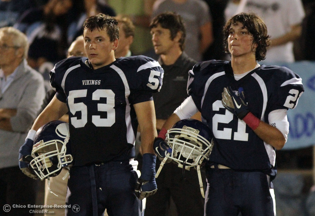. Chico High against Pleasant Valley High\'s #53 John Davis (left) and #21 Darien Laufer (right) in the first quarter during their Almond Bowl XLI football game at CSUC University Stadium Friday, October 21, 2011 in Chico, Calif. (Jason Halley/Chico Enterprise-Record)