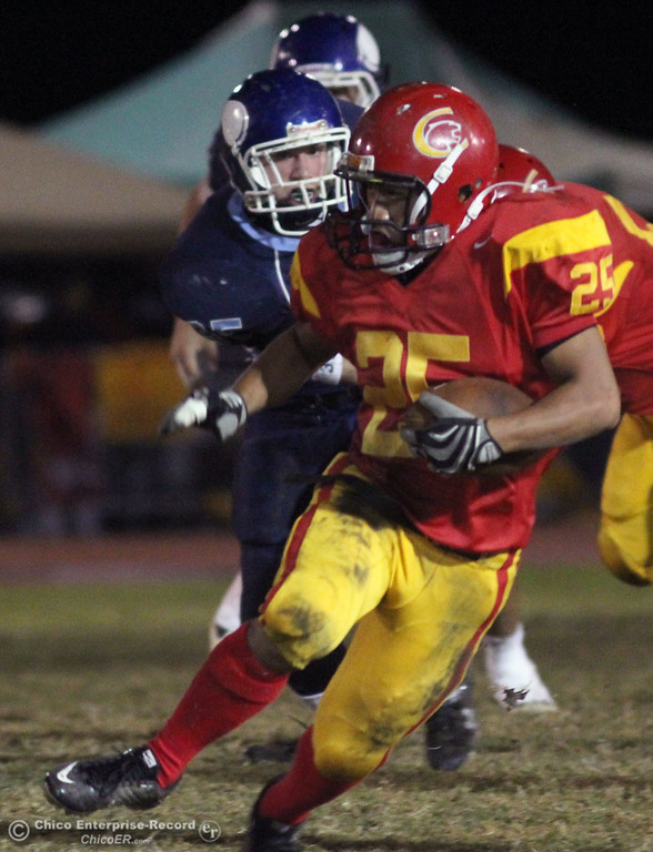 . Pleasant Valley High against Chico High\'s #25 Ger Lee rushes in the second quarter of their Almond Bowl football game at CSUC University Stadium Friday, October 22, 2010 in Chico, Calif.