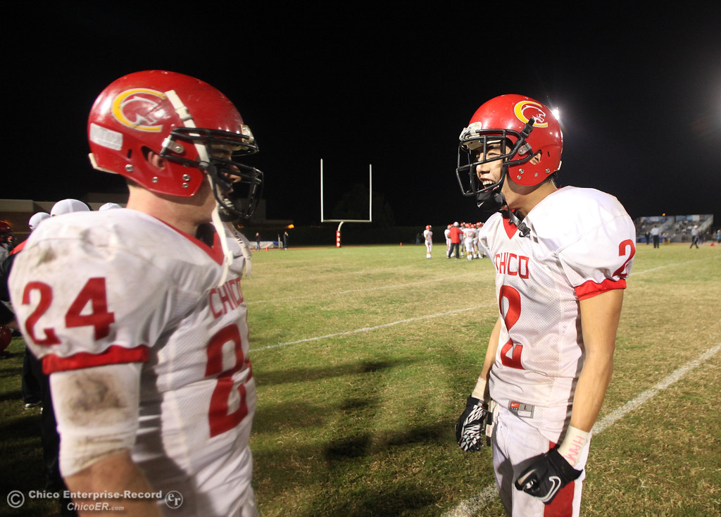 . Chico High\'s #24 Kyle Twisselman (left) and #2 Aaron Chu (right) against Pleasant Valley High in the fourth quarter during their Almond Bowl XLI football game at CSUC University Stadium Friday, October 21, 2011 in Chico, Calif. (Jason Halley/Chico Enterprise-Record)