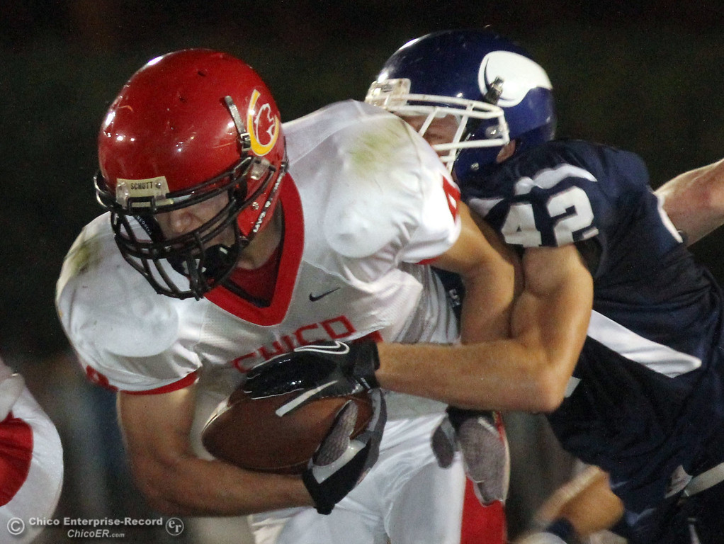 . Chico Highs #44 Mark Jorgensen (left) is tackled against Pleasant Valley High\'s #42 Chad Olsen (right) in the first quarter during their Almond Bowl XLI football game at CSUC University Stadium Friday, October 21, 2011 in Chico, Calif. (Jason Halley/Chico Enterprise-Record)