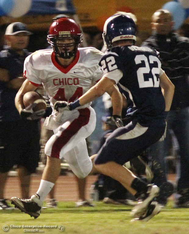 . Chico High\'s #44 Mark Jorgensen (left) rushes against Pleasant Valley High \'s #22 Michael Gerlach (right)in the first quarter during their Almond Bowl XLI football game at CSUC University Stadium Friday, October 21, 2011 in Chico, Calif.