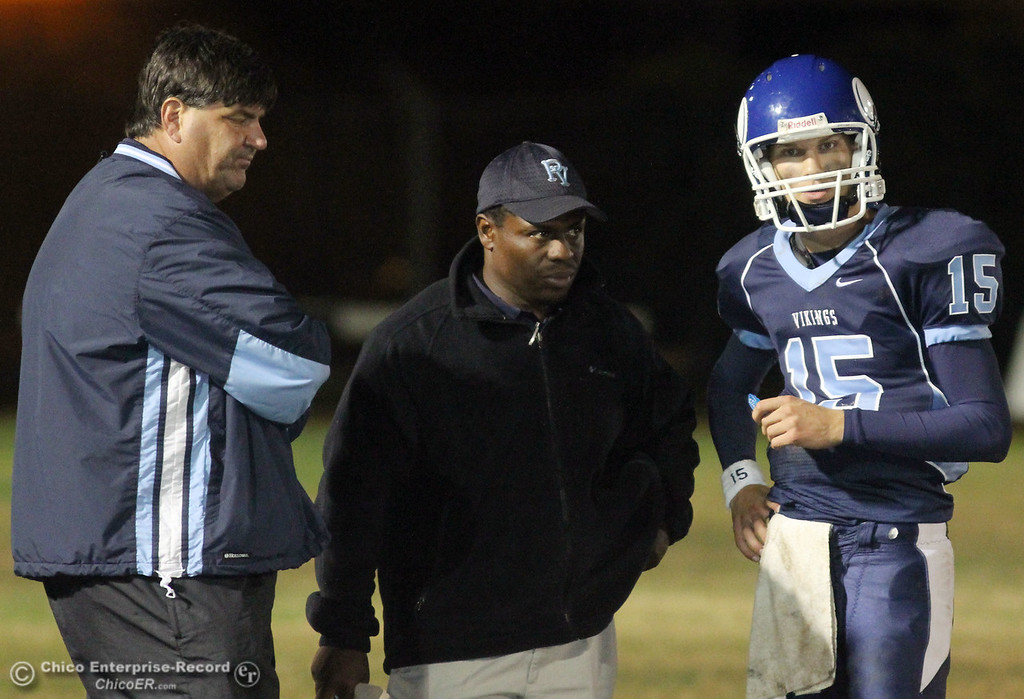 . Pleasant Valley High\'s coaches Craig Rigsbee (left) Sterling Jackson (center) talk with QB Will Christensen (right) against Chico High in the second quarter of their Almond Bowl football game at CSUC University Stadium Friday, October 22, 2010 in Chico, Calif.