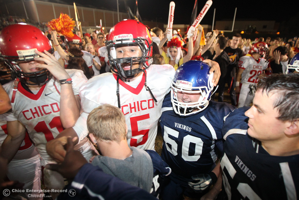 . Chico High\'s #5 Trevon Reid (left) against Pleasant Valley High\'s #50 A.J. Harrod (right) after the fourth quarter during their Almond Bowl XLI football game at CSUC University Stadium Friday, October 21, 2011 in Chico, Calif. (Jason Halley/Chico Enterprise-Record)