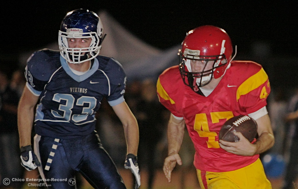 . Chico High\'s #47 Ian Boyer (right) rushes against Pleasant Valley High\'s #33 Jeremy Andreasan (left) in the second quarter of their Almond Bowl football game at CSUC University Stadium Friday, October 16, 2009 in Chico, Calif.
