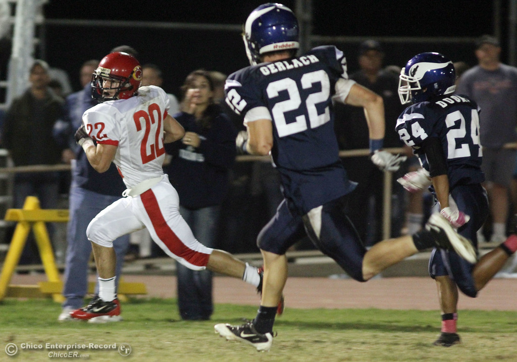 . Chico High\'s #22 Stefano Disano (left) rushes against Pleasant Valley High\'s #22 Michael Gerlach, and #24 Robin Duong (right) in the first quarter during their Almond Bowl XLI football game at CSUC University Stadium Friday, October 21, 2011 in Chico, Calif. (Jason Halley/Chico Enterprise-Record)