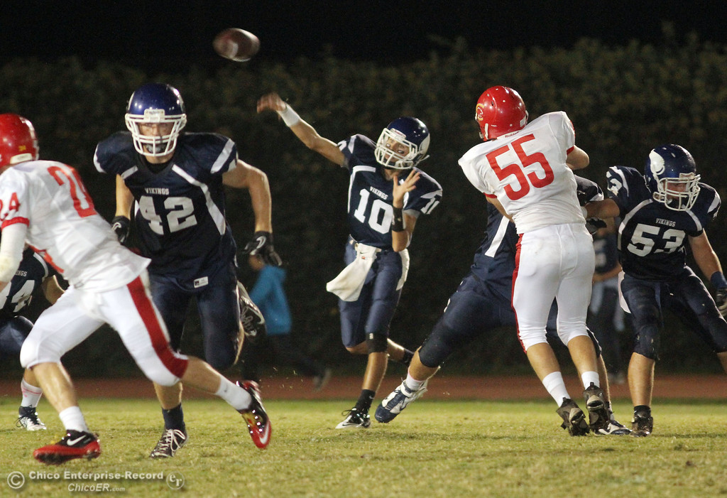 . Chico High against Pleasant Valley High\'s #10 Eric Ascencio (center) in the first quarter during their Almond Bowl XLI football game at CSUC University Stadium Friday, October 21, 2011 in Chico, Calif. (Jason Halley/Chico Enterprise-Record)