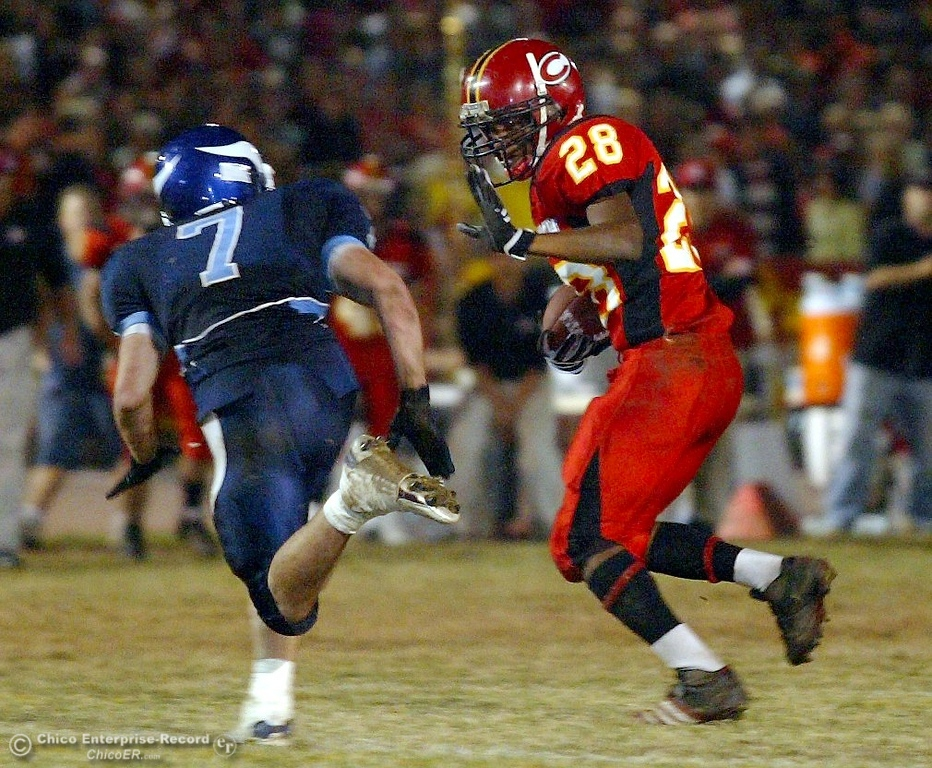 . Chico High\'s #28 Jamiel Hardman (right) rushes against Pleasant Valley High\'s #7 Brandon Nickas (left) in the first quarter of their 2008 Almond Bowl Football game Friday, October 17, 2008 at CSUC University Stadium in Chico, CA. 