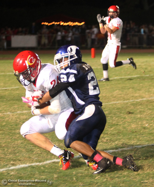 . Chico High\'s #24 Kyle Twisselman (left) catches against Pleasant Valley Highs #24 Robin Duong (right) in the second quarter during their Almond Bowl XLI football game at CSUC University Stadium Friday, October 21, 2011 in Chico, Calif. (Jason Halley/Chico Enterprise-Record)