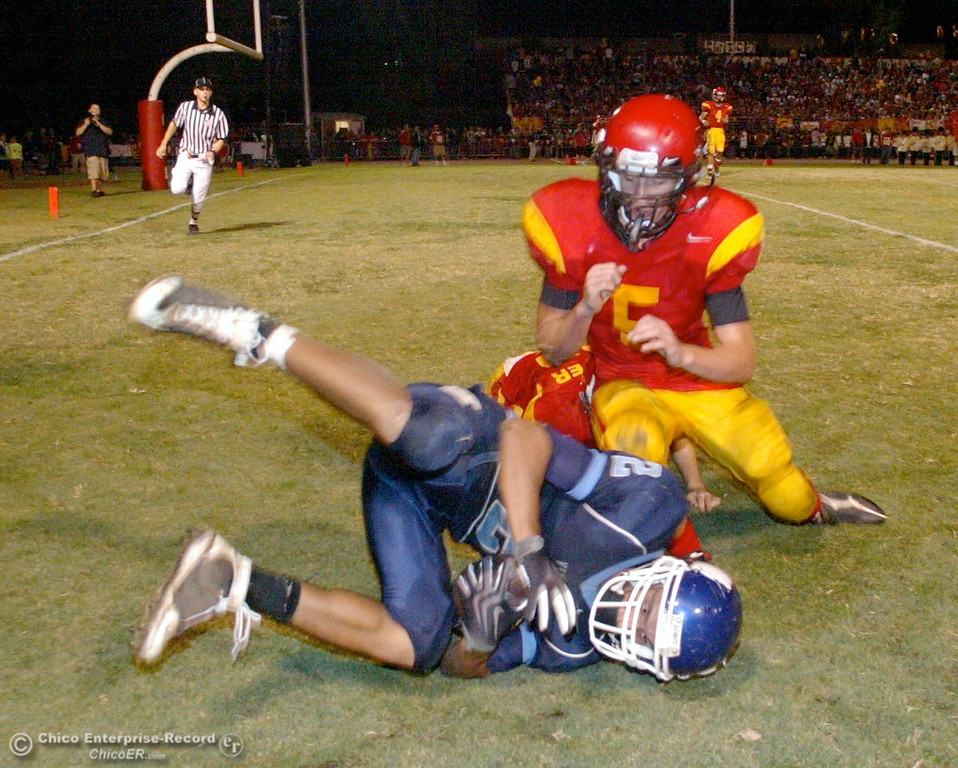 . Chico High\'s #47 Ian Boyer (back) and #9 Corrie Emmons (top) is unable to stop against Pleasant Valley High\'s #2 Joe Valencia from catching a touchdown pass in the first quarter of their Almond Bowl football game at CSUC University Stadium Friday, October 16, 2009 in Chico, Calif. (Jason Halley/Chico Enterprise-Record)