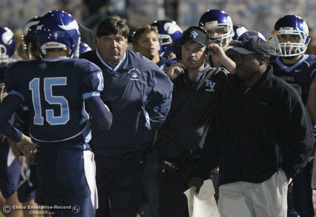 . Pleasant Valley High\'s coaches Craig Rigsbee (left) and Sterling Jackson (right) against Chico High in the first quarter of their Almond Bowl football game at CSUC University Stadium Friday, October 22, 2010 in Chico, Calif.