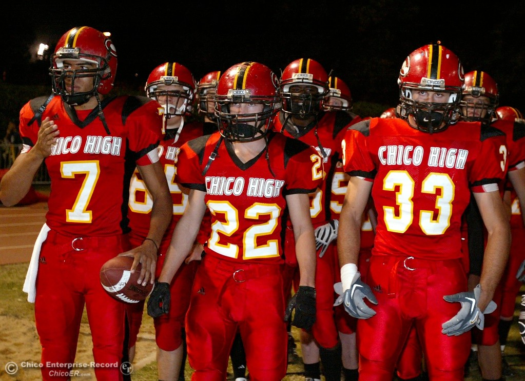 . Chico High\'s #7 Nate Anderson, #22 Austin Somhegyi, #33 Kayhan Karatekeli, (left to right) against Pleasant Valley High in the first quarter of their 2008 Almond Bowl Football game Friday, October 17, 2008 at CSUC University Stadium in Chico, CA. 
