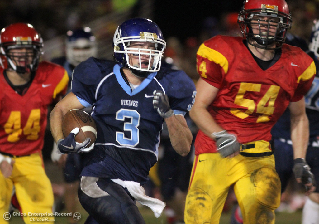 . Pleasant Valley High\'s #3 Gary Hemmingsen (center) rushes against Chico High\'s #54 Mike Davis (righ) in the second quarter of their Almond Bowl football game at CSUC University Stadium Friday, October 22, 2010 in Chico, Calif.