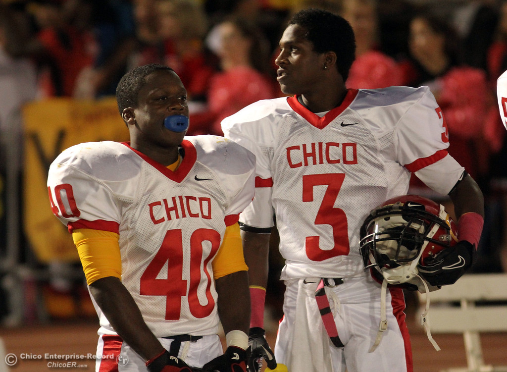 . Chico High\'s #40 Ricky Greenwade (left) and #3 Vince Allen (right) against Pleasant Valley High in the first quarter during their Almond Bowl XLI football game at CSUC University Stadium Friday, October 21, 2011 in Chico, Calif. (Jason Halley/Chico Enterprise-Record)