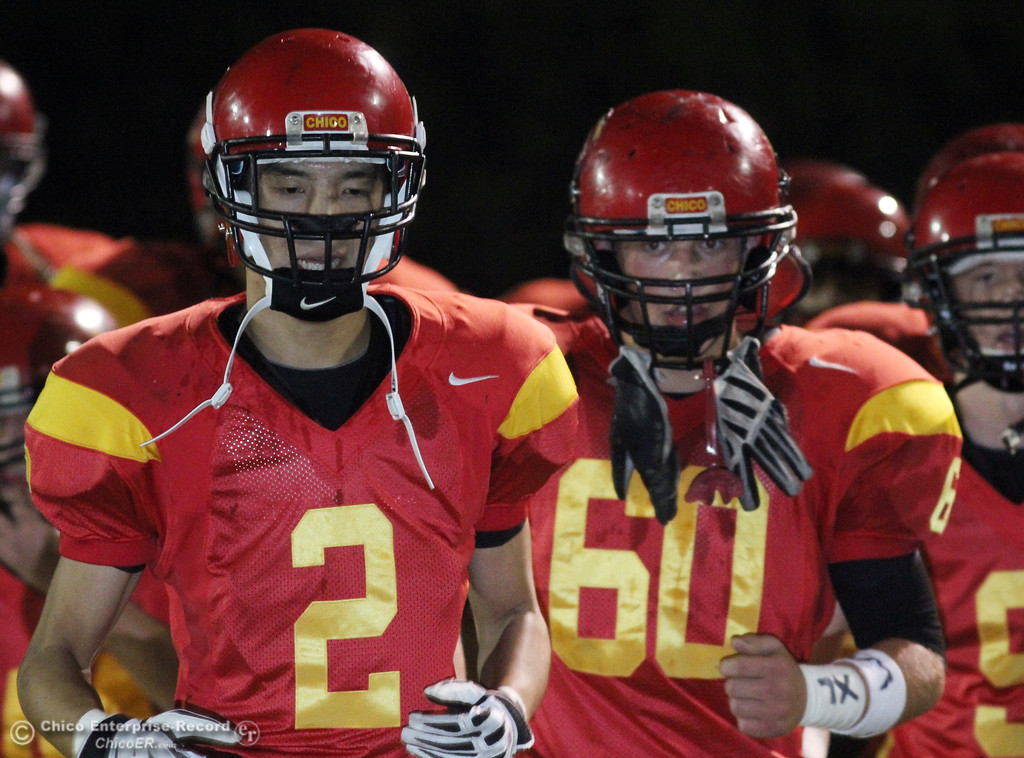 . Pleasant Valley High against Chico High\'s #2 Aaron Chu (left) and #60 Jeff Parrish (right) in the first quarter of their Almond Bowl football game at CSUC University Stadium Friday, October 22, 2010 in Chico, Calif.