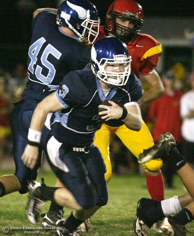 . Pleasant Valley High\'s #3 Ryan Powers rushes against Chico High in the first quarter of their Almond Bowl football game at CSUC University Stadium Friday, October 16, 2009 in Chico, Calif. (Jason Halley/Chico Enterprise-Record)