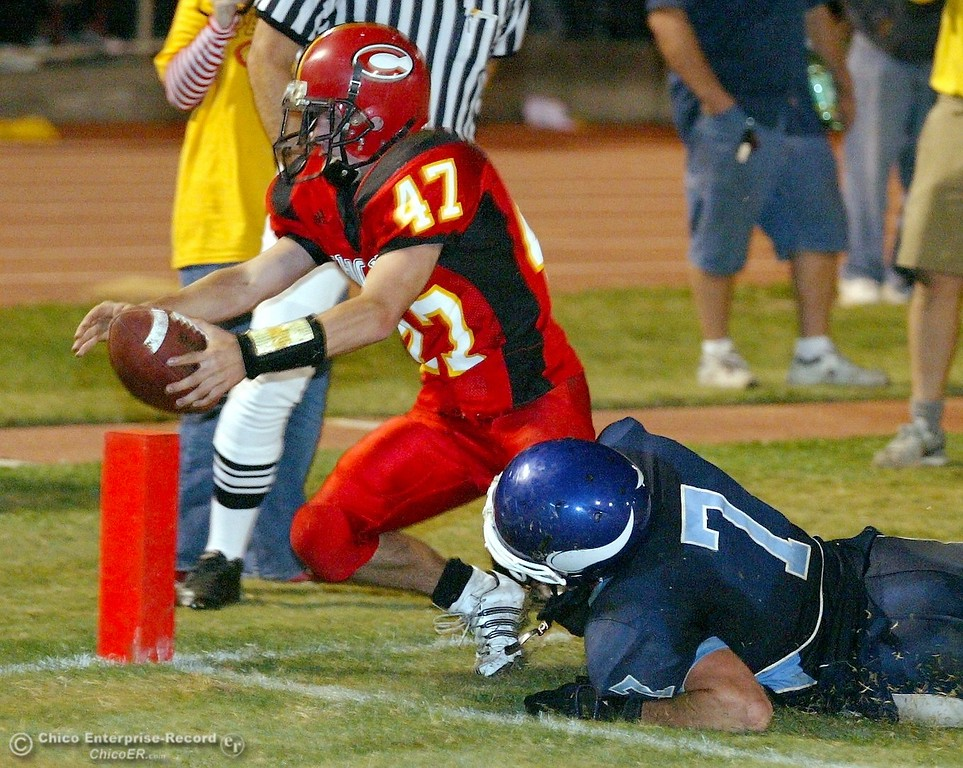 . Chico High\'s #47 Ian Boyer (left) reaches in to score a touchdown as he is tackled by Pleasant Valley High\'s #7 Brandon Nickas (right) in the first quarter of their 2008 Almond Bowl Football game Friday, October 17, 2008 at CSUC University Stadium in Chico, CA. 
