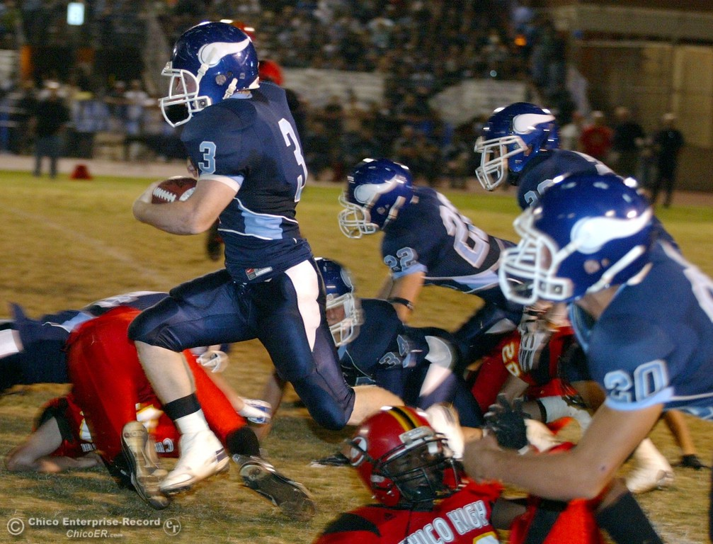 . Pleasant Valley High\'s #3 Ryan Powers (left) rushes through Chico High in the first quarter of their 2008 Almond Bowl Football game Friday, October 17, 2008 at CSUC University Stadium in Chico, CA. 