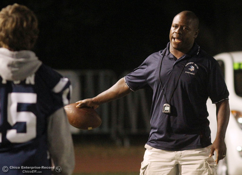 . Pleasant Valley High head coach Sterling Jackson readies against Chico High before the first quarter during their Almond Bowl XLI football game at CSUC University Stadium Friday, October 21, 2011 in Chico, Calif. (Jason Halley/Chico Enterprise-Record)