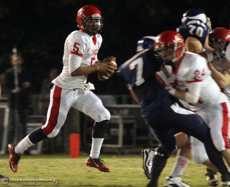 . Chico High\'s #5 Trevon Reid (left) rushes against Pleasant Valley High in the first quarter during their Almond Bowl XLI football game at CSUC University Stadium Friday, October 21, 2011 in Chico, Calif. (Jason Halley/Chico Enterprise-Record)