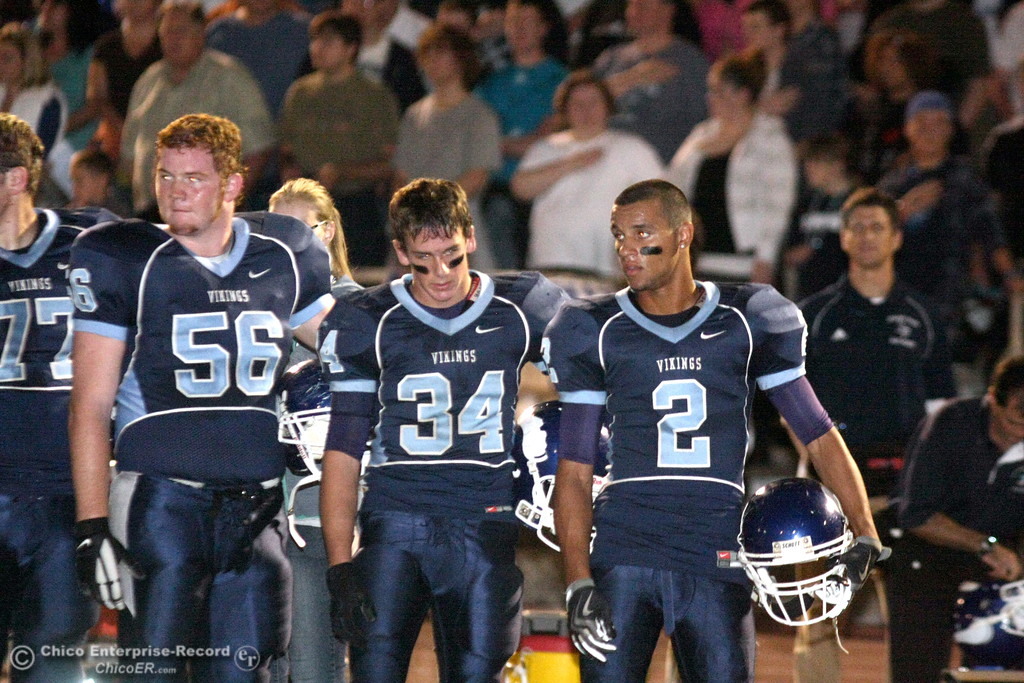 . Chico High against Pleasant Valley High\'s #56 Kenny Young, #34 Joey Ruth, and #2 Logan Valencia at the national anthem before the first quarter of their Almond Bowl football game at CSUC University Stadium Friday, October 16, 2009 in Chico, Calif. (Jason Halley/Chico Enterprise-Record)