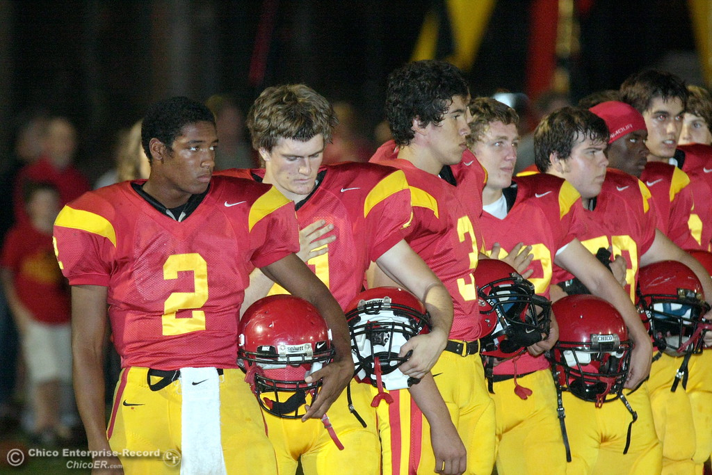 . Chico High\'s #2 Jamiel Hardman (left) at the national anthem against Pleasant Valley High before the first quarter of their Almond Bowl football game at CSUC University Stadium Friday, October 16, 2009 in Chico, Calif. (Jason Halley/Chico Enterprise-Record)